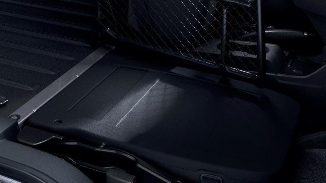 Siège passager rabattable et repliable formant plancher plat